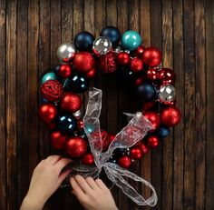 Craft a perfect holiday wreath for your door with Xmas ball ornaments. Christmas Door Wreaths, Holiday Wreaths, Holiday Crafts, Christmas Time, Christmas Decorations, Xmas, Holiday Decor, Ball Ornaments, Ornament Wreath