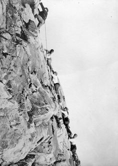 """Climbing the head of western lion"". Photo taken circa 1910, courtesy the Vancouver Archives."