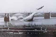 Russian pilot Valentin Privalov flying under the central span the bridge over river Ob. June 14, 1965.