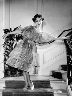 1959 Model in pleated cocktail dress by Yves Saint Laurent