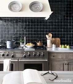 Lovely handmade black tile with white grout. Note the grey stained cabinets.