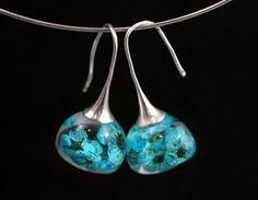 Real blossom earrings. Turquoise real flowers in resin