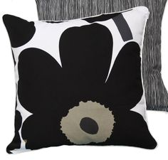 This is one beautiful cushion cover, beautifully made. With white piping, a black and white striped back and the classic Marimekko Unikko image on the front thi