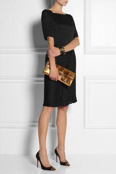Sick gold clutch with a little black dress