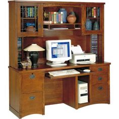 979.98 Give your office a special touch with this computer desk and optional hutch. From the arched valance at the top to the glass fronts on the cabinets, this desk and hutch adds not only storage but a...
