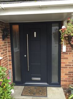 A modern Antracite Grey Dakota composite door fitted with 2 glass side panels . … A modern Antracite Grey Dakota composite door fitted with 2 glass side panels . Grey Front Doors, Front Door Porch, Front Porch Design, Modern Front Door, Front Door Entrance, Exterior Front Doors, House Front Door, Front Door Colors, Glass Front Door