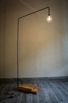 SiO2   Handmade floor lamp. MATERIALS: lebanese cedar wood-iron