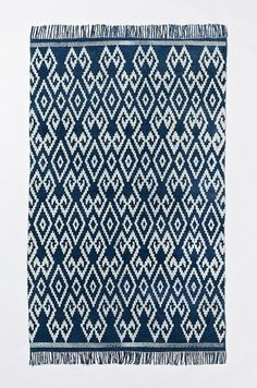 Thinking about layering this with my current living room rug.  Indigo Geo cotton dhurrie | West Elm #stylecure