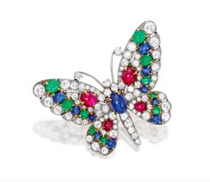 Sotheby's Magnificent Jewels Auction | Julers Row: Lot 391: 18 Karat Gold, Platinum, Colored Stone and Diamond Brooch, Bulgari