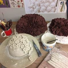 Working on the last few Christmas orders. Large and medium DELPHINE wall pieces drying out in the background and a porcelain DAISY wall piece in progress in the foreground. #porcelain #clay #blackclay #ceramics #handbuilding #handmade #flowers #petals #wallart #wallpiece #wallflower
