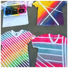 Supplies: White tshirt, fabric spray paint, and tape. Tape a cool design you want on your shirt, then spray paint what colors you want. Let your shirt dry and take the tape off.