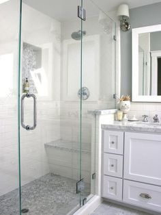 master bath; shower with glass door.  small tile on floor, subway tile on walls, glass door...I love everything except the color.