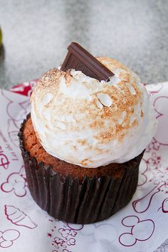 S'mores Cupcake - Graham Cracker Cake with chocolate chips, topped with marshmallow frosting and a Hershey's square - from the Disney Cupcake Crawl
