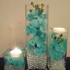 Simple DIY center pieces. This just substitute orchids with my colors or simple cream colored flowers.
