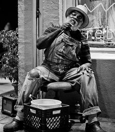 """Grandpa Elliott Small, born Elliot Small in 1944, also known as Uncle Remus, is a street-musician in New Orleans, Louisiana. He plays the harmonica, sings, and is a street icon in New Orleans. He has been featured on Playing for Change in several episodes. His debut song with Playing for Change was """"Stand by Me"""". He has also been on The Tonight Show and The Colbert Report. He has been a street icon on Royal Street in the French Quarter and Jackson Square in New Orleans. Jørn Veberg photo."""