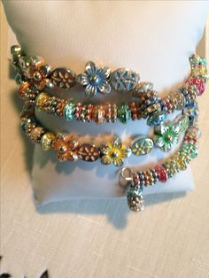 Fun,colorful,summer memory wire bracelet.Different shapes and colors to please the eye.All silver plated beads.Memory wire spirals on wrist. Holds shape when taken off.
