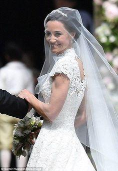 Pippa Middleton Wedding Dress - The blushing bride beamed with joy and flashed a smile to the waiting photographers