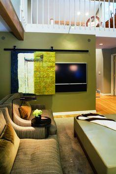 Hide TV behind sliding art