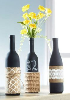 Painted old wine bottles as table number and doubles as a flower vase