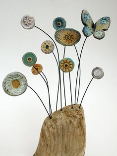 Shirley Vauvelle, Mixed Media Artist / Nodding Flowers and Butterfly  (earthenware and driftwood, 25cm x 11cm x 5cm)