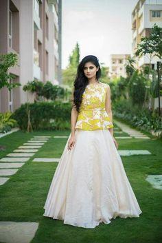 Love this lemon yellow peplum lehenga blouse with white plain lehenga skirt. Party Wear Indian Dresses, Indian Gowns Dresses, Indian Fashion Dresses, Dress Indian Style, Indian Designer Outfits, Designer Dresses, Indian Skirt, Designer Clothing, Pakistani Dresses
