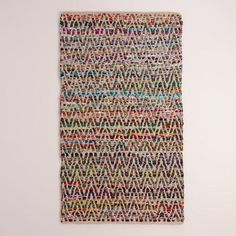 Featuring a chevron design in a rainbow of bright colors, our unique area rug is handwoven from reclaimed 100% cotton fabric remnants. This eco-chic update to traditional chindi rugs is only available at World Market.