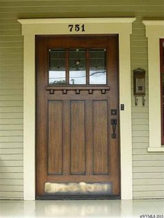 Craftsman door...I love the ledge that allows someone to leave a note or a small package...and kickplate