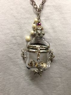 Soldered Glass Reliquary Hinged Bottle Necklace. $34.00, via Etsy.
