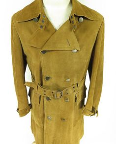 This is a vintage 'spy' style trench coat by CEO Sweeden.