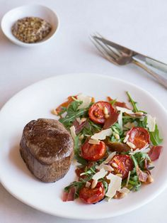 Best ever steak with a rocket, tomato and prosciutto salad recipe
