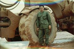 US Army 630th Engineer Company soldier stands beside a Clark 290 scraper, 1970.