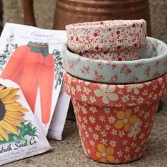 fabric-covered flower pots! this i can do! MIL gift?