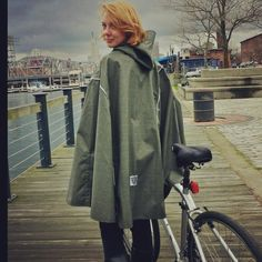 Green rubberlined poncho .............ideal for cycling.