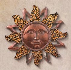 Grasslands Road Sun Face Plaque by Grasslands Road. $55.00. Hardware on back for hanging. Dimensions: 15-1/2 x 15-1/2 x 1-1/2 inch. Resin/glass. Celestial sun shaped wall plaque with mosaic glass accents. Perfect for indoor/ outdoor decor. Eye-catching celestial appeal makes the Grasslands Road Sun Face Plaque perfect for both indoor and outdoor decorating.