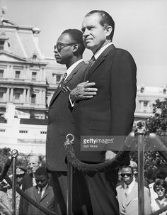 American president Nixon (foreground) stands next to Congo president Joseph Desire Mobutu as national anthems of both countries are played, Washington, D. C.