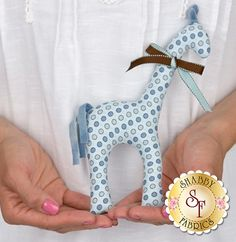 Gerry Giraffe Petite Pattern: Gerry is a kind giraffe and promises not to make dents in your ceiling if you invite him into your home! Pattern includes all instructions for the 9