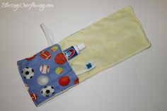 travel toothbrush holder from a hand towel tutorial via Blessings Overflowing