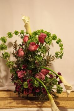 HEARTS $132.00 This arrangement is done on a small easel to be placed at a cremation site or table top at parlor.