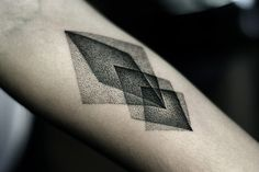 Geometric pointillism tattoo.