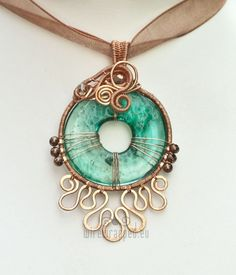 wire wrapped pendants.  Sorry - there isn't a tutorial  attached to this.  But this artist has some incredible pieces I'd love to get my hands on.