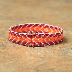 Red & Orange Chevron Beaded Bracelet by PuebloAndCo on Etsy.     Note the clasp!  Can make them myself out of wire.