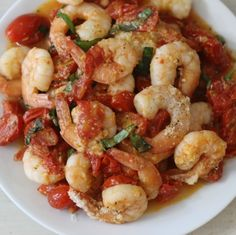 Shrimp with Garlic and Tomatoes- a quick one pan meal Italian dish with sauteed tomatoes, garlic and shrimp which has been topped with Parmesan cheese.