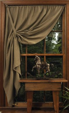 Simple tie back curtain....love it pulled toward the top on one side.....drapes well! Sooo plain and prim!
