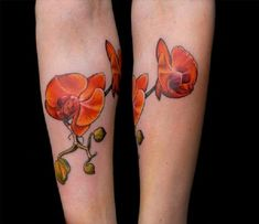Beautifully Done Orchid tattoo. Another orchid tattoo in orange. We simply can't resist its looks. Can you?