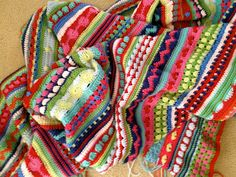 http://littlewoollie.blogspot.com/p/mixed-stitch-stripey-blanket-crochet.html