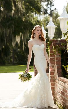This Martina Liana fit-and-flare silhouette is made from fine lace and Royal organza over Luxe satin and features a dreamy sweetheart neckline and illusion lace back. The back zips up under fabric-covered buttons.  http://www.houseofmayabridal.com/pure-english/