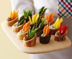 Cut a baguette on an angle, scoop out a little, fill with dip, add a few strips of veggies.  #Hors d'oeuvres   #appetizers