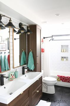WOW, WOW, WOW! This DIY bathroom remodel is by far one of the best I have seen, and they REALLY did all the work themselves! I love the floor to ceiling subway tile, the black slate tile floor and the penny tile accents. And that floating vanity is amazing.