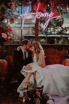 romantic wedding photo under neon wedding signs
