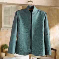 Boteh Embroidered Silk Jacket from National Geographic, with the following caption:  Boteh, mango leaf, even Welsh pear—the pattern most commonly known as paisley in the West goes by many different names. This hand-loomed silk dupioni jacket is a classic cut that shows off the texture and play of light in the fabric. Dupioni is often woven with different colors in the warp and weft to create an iridescent effect.